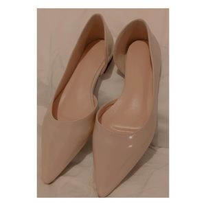 Cream patent-look pointed flats. Never been worn.